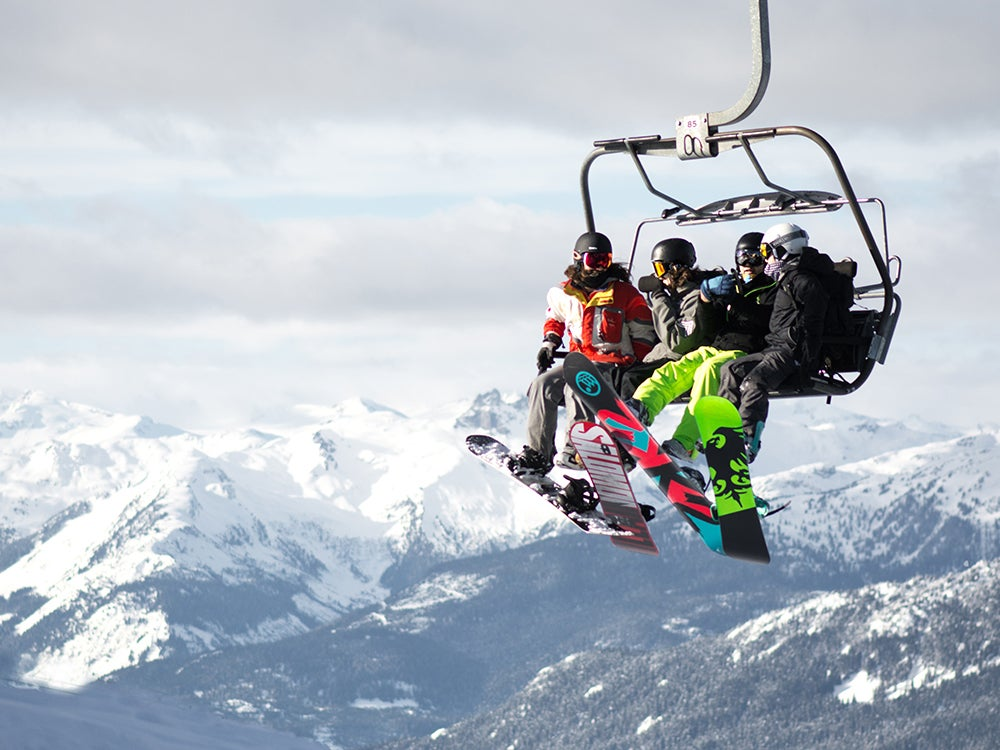 snowboarders on the lift