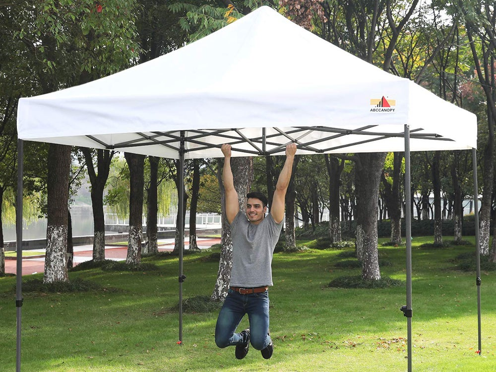 Man hanging on a popup canopy