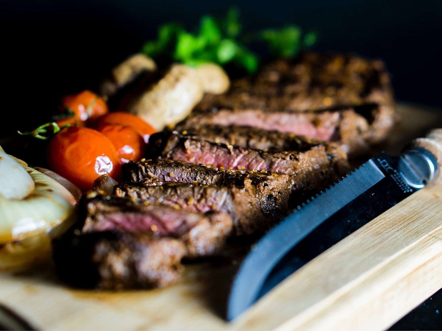Cooked and cut steak on the cutting board