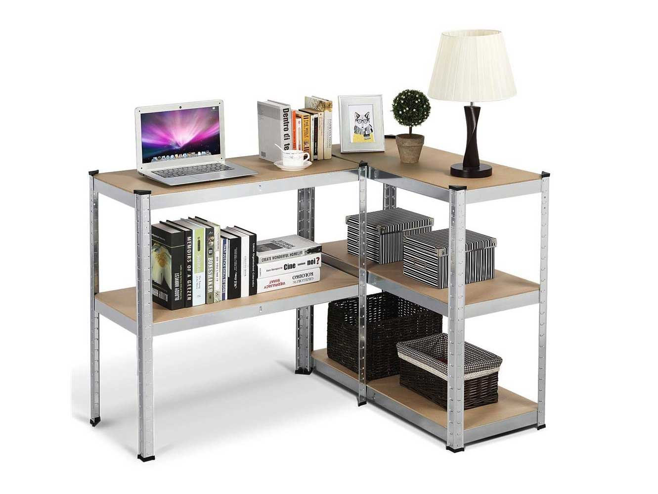 Shelving unit with books, baskets, plant, laptop, and lamp.