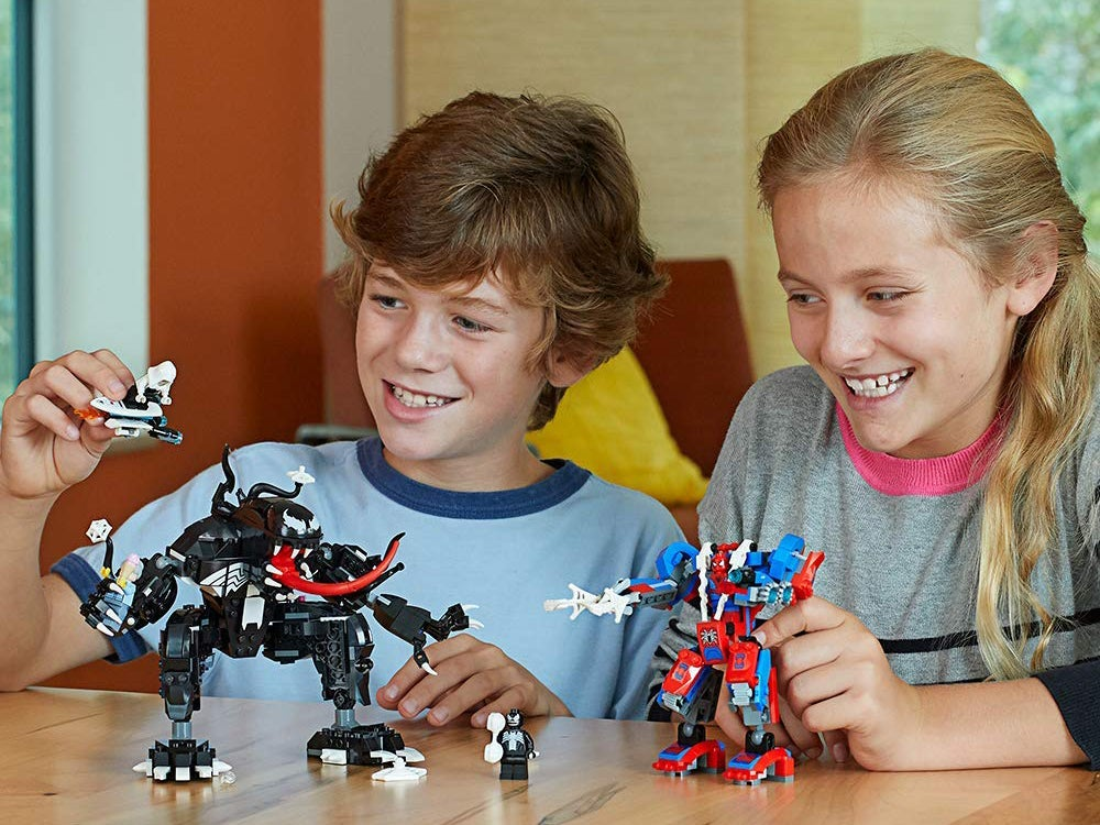 Kids playing with Spiderman LEGOs