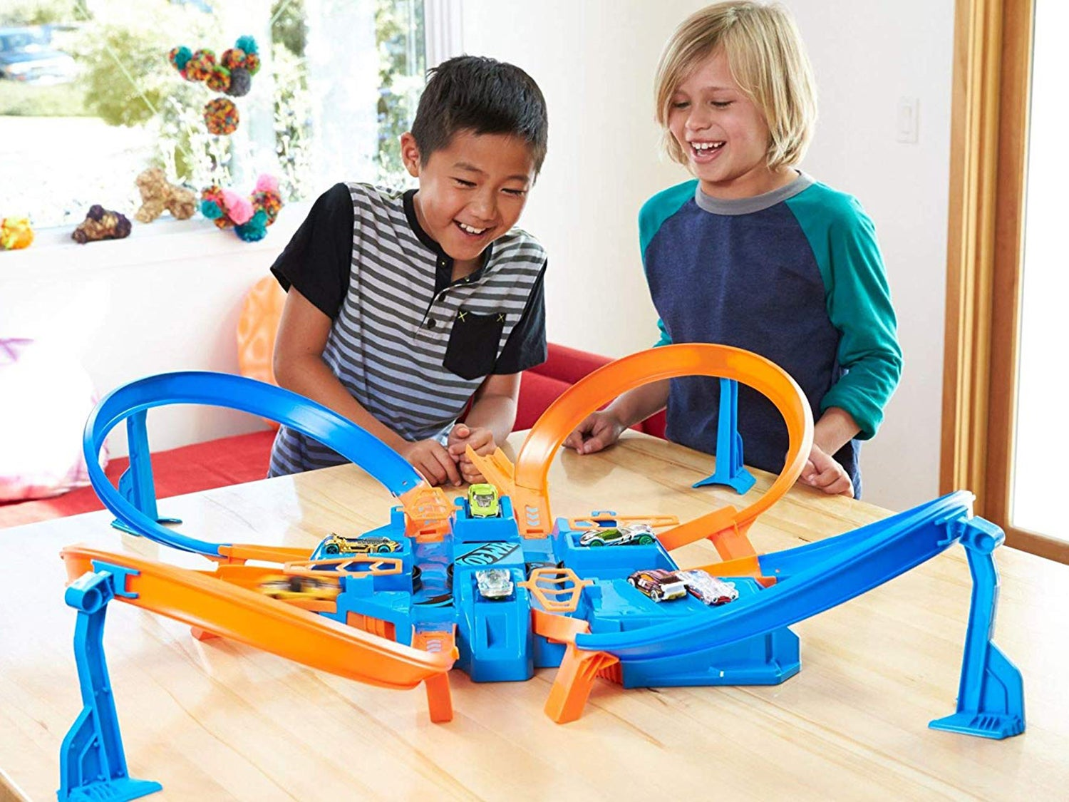 kids playing with hot wheels track