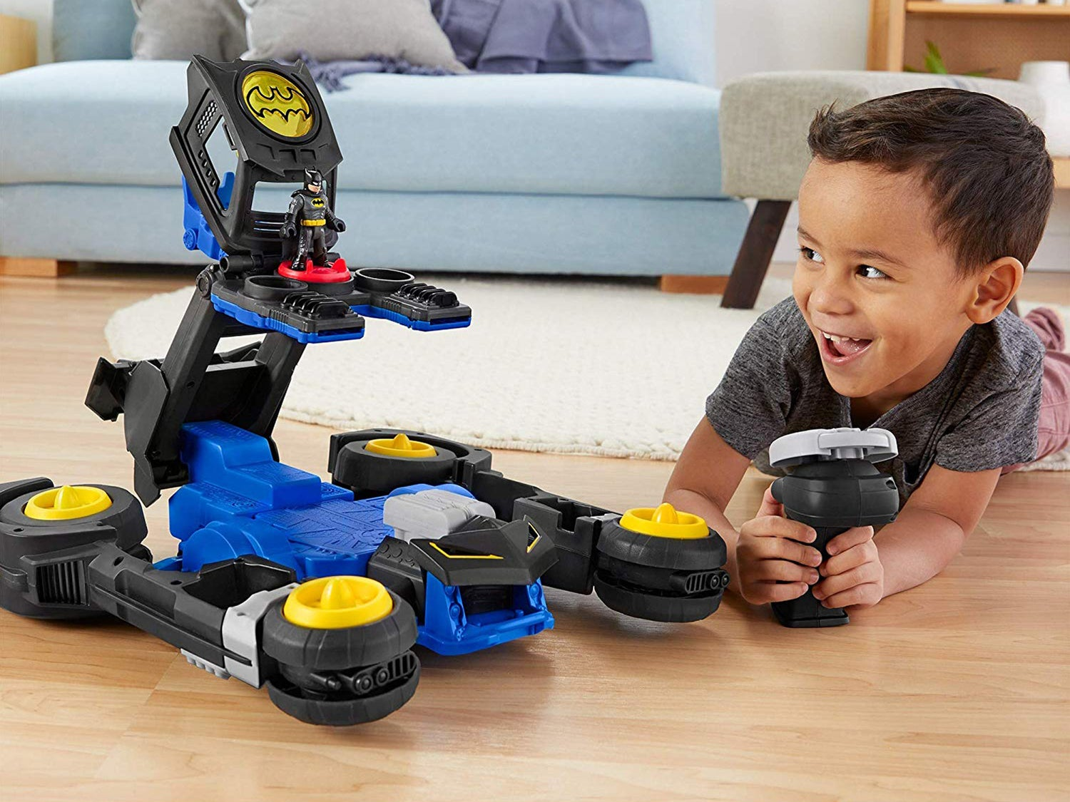 Kid playing with batman toys