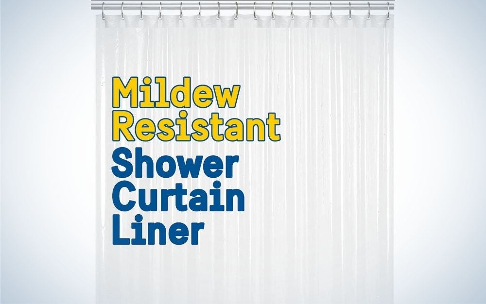 A long and white shower curtain all with a blue and yellow inscription on it.