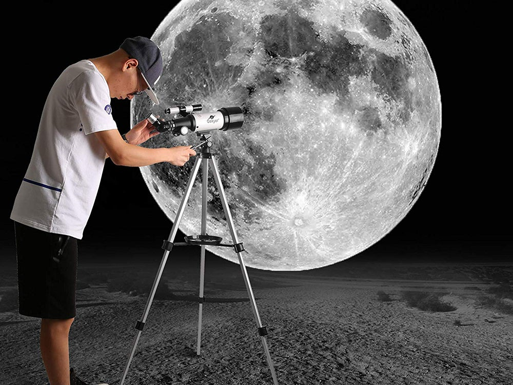 kid looking at the moon through telescope