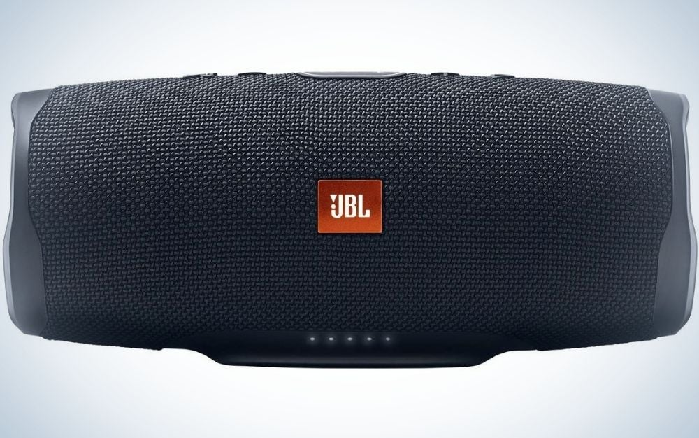 A black rectangular speaker with the JBL logo in the middle and without a plug.