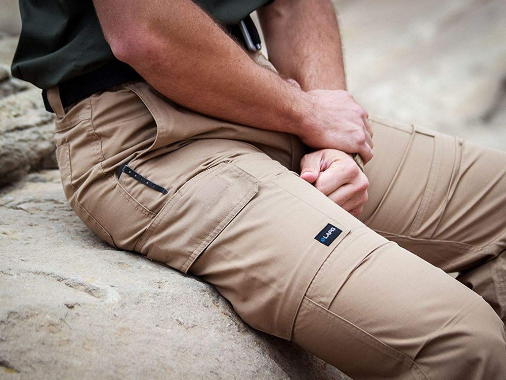 Sitting on a big rock in cargo pants