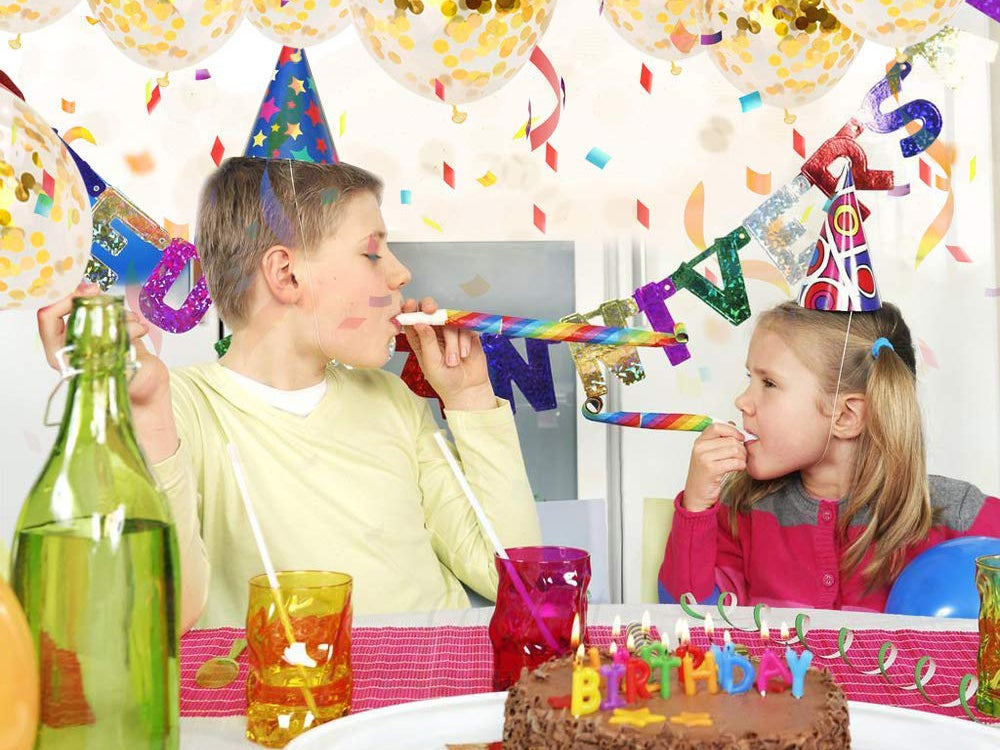 Kids celebrating at a party with party hats and favors