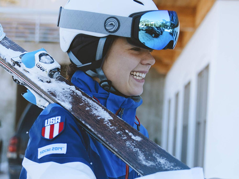 smiling Skier with skis and goggles