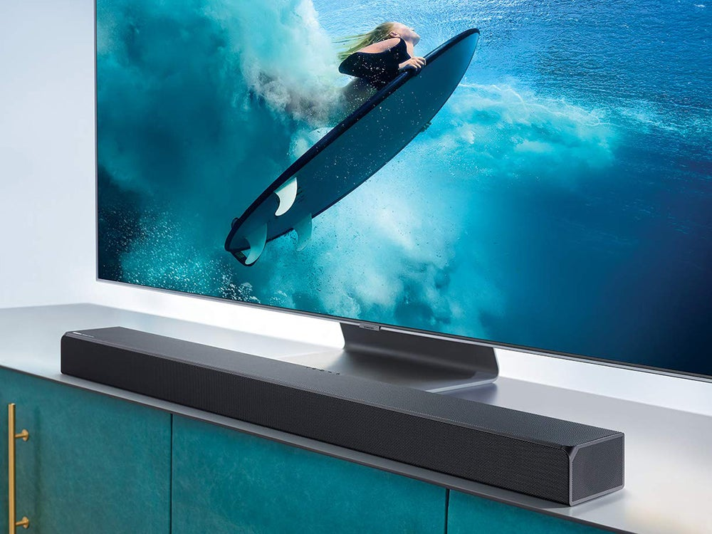Soundbar in front of a flat screen TV with a surfer