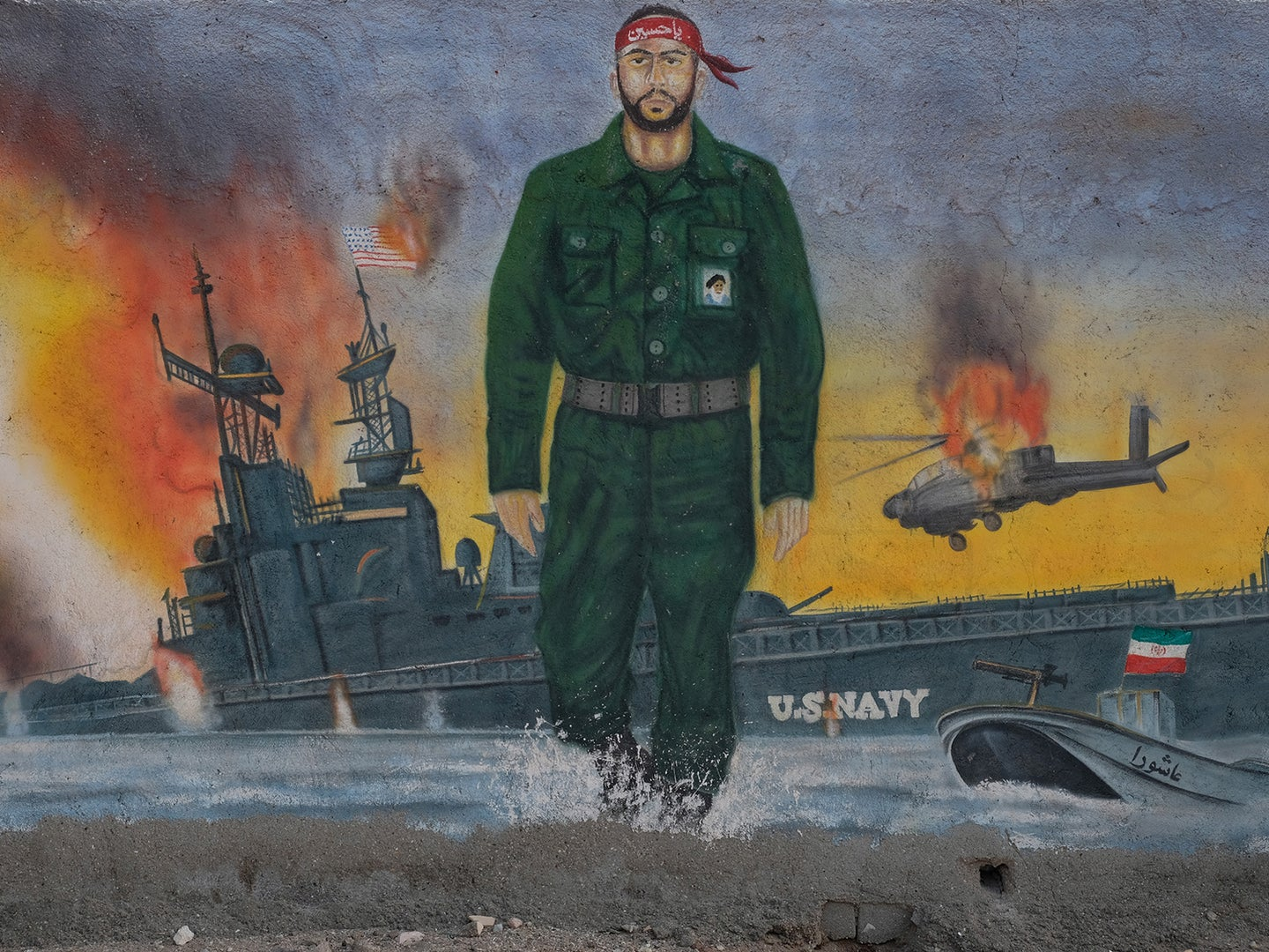A mural depicts the past conflicts between Iran's revolutionary guards and U.S. navy in the Strait of Hormuz on May 2, 2017 in Hormuz Island, Iran