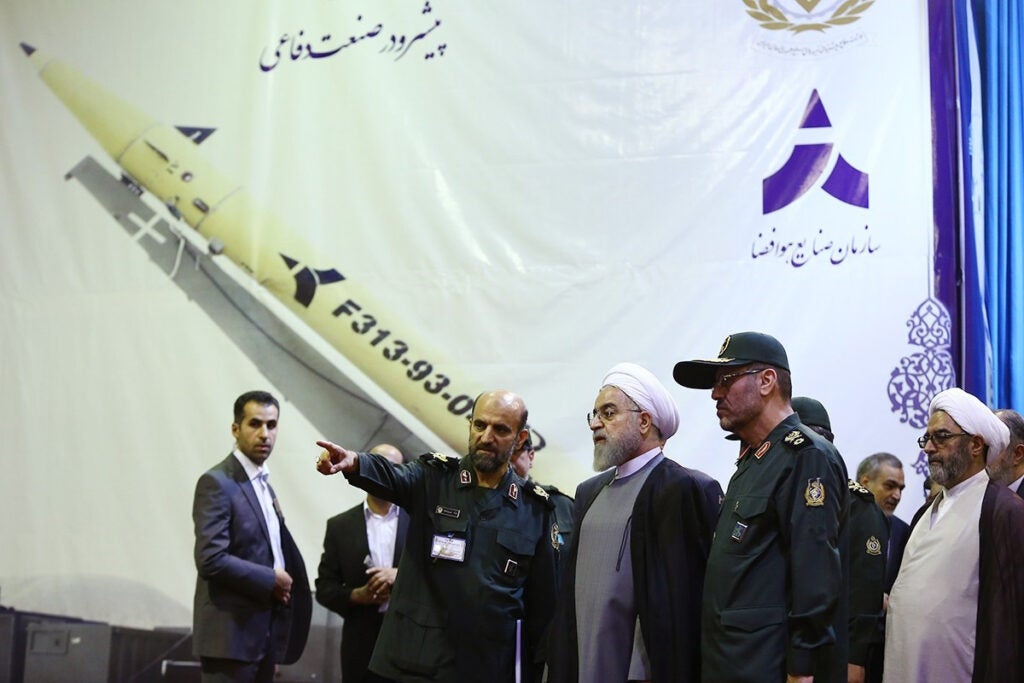 Iran's President Hassan Rouhani (C) attends the unveiling the surface-to-surface Fateh-313