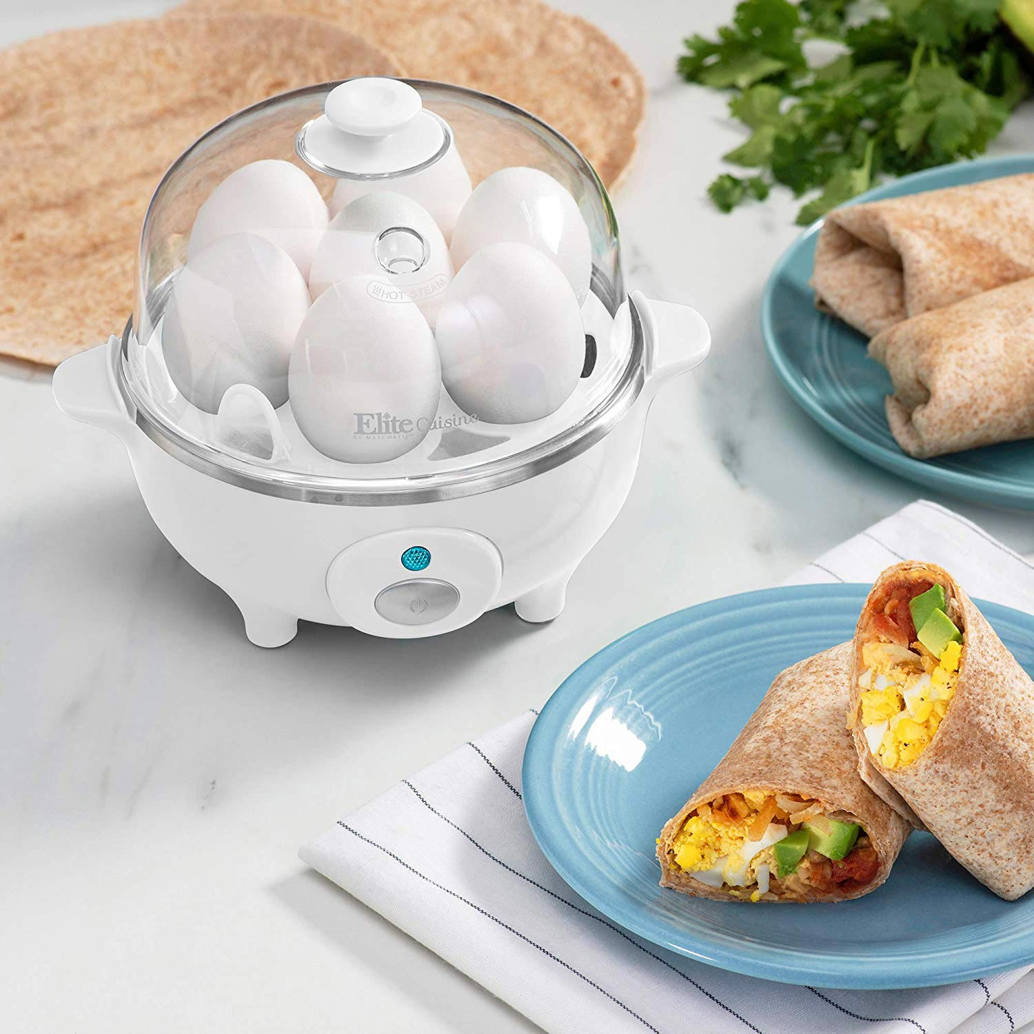 Egg cooker on a table with some breakfast foods