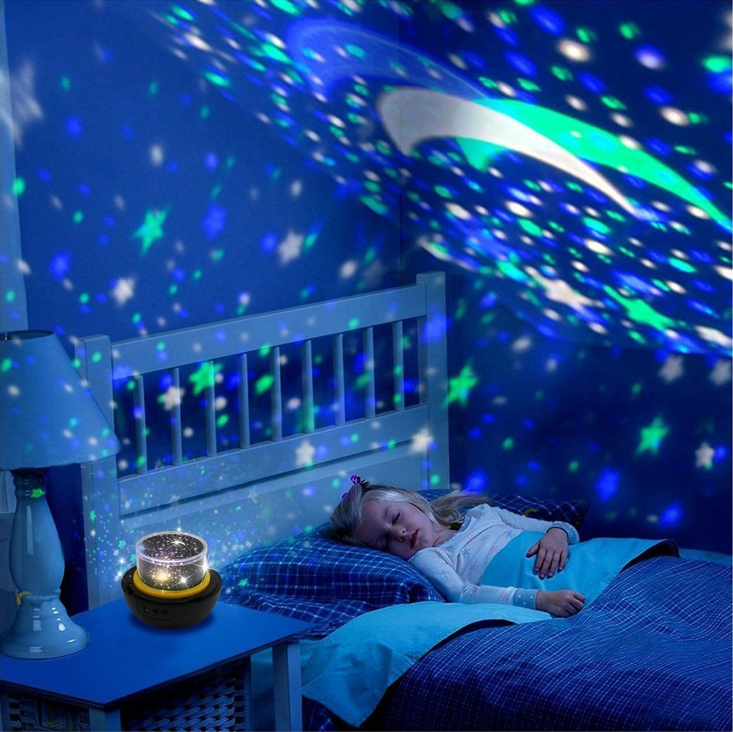 a child sleeping in a bed with a projected night-light.