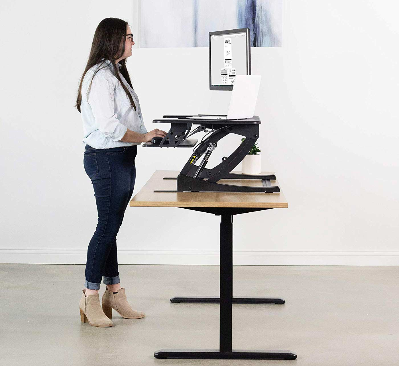 Woman using a standing desk.