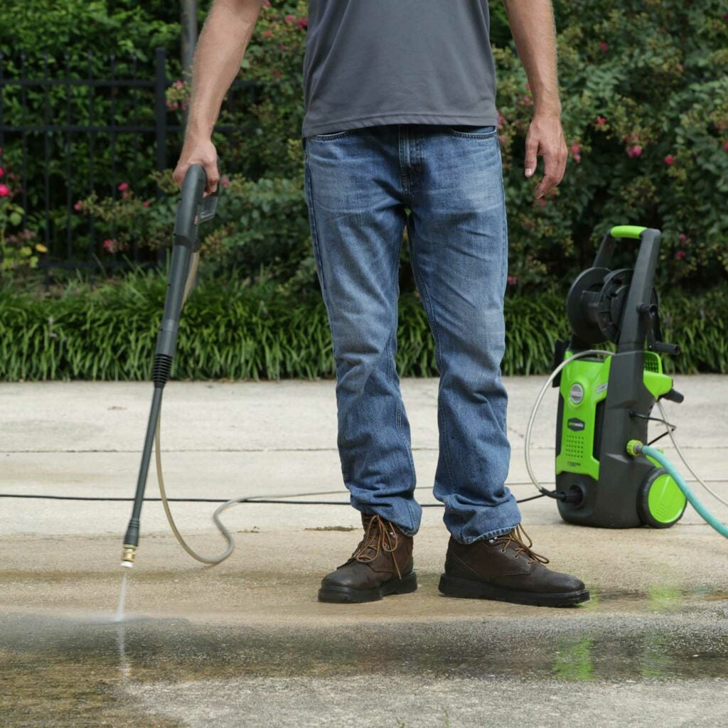 Man using a power washer.