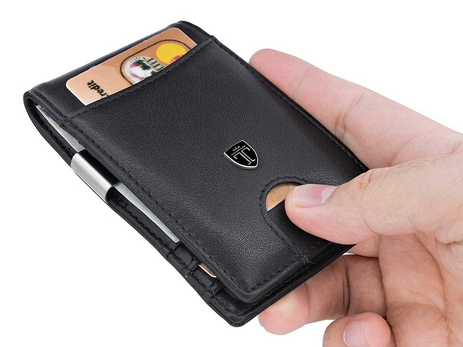 Holding an RFID-blocking wallet with credit card.