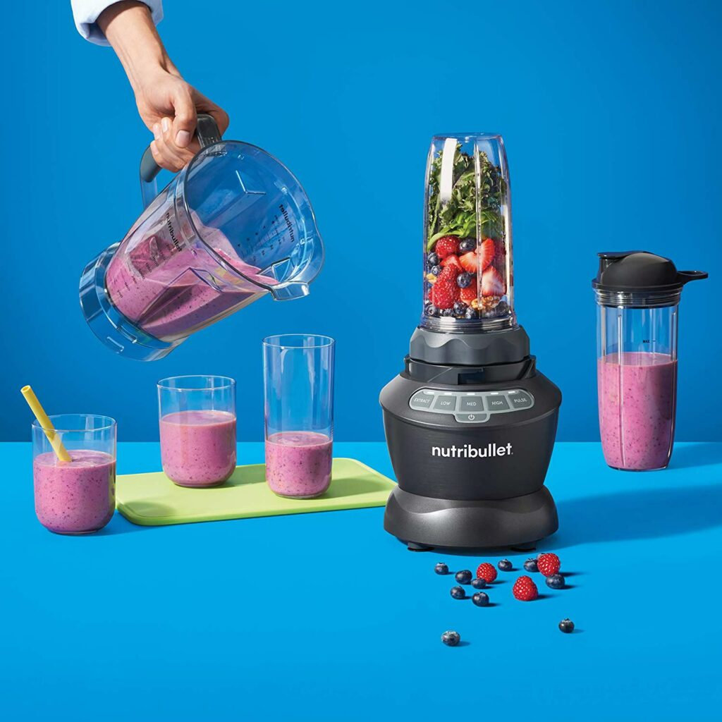 Person making smoothies with a blender
