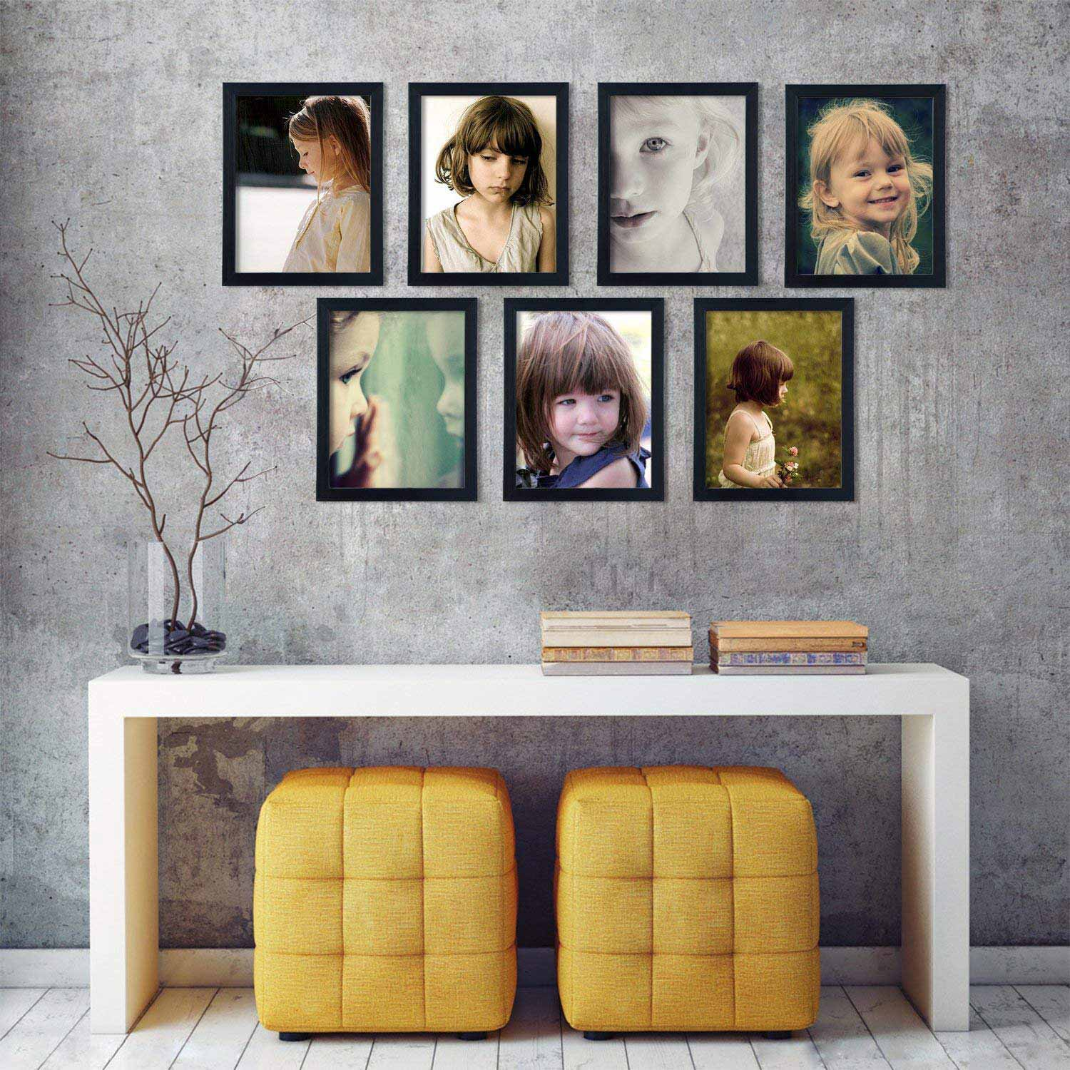 Living room wall filled with picture frames