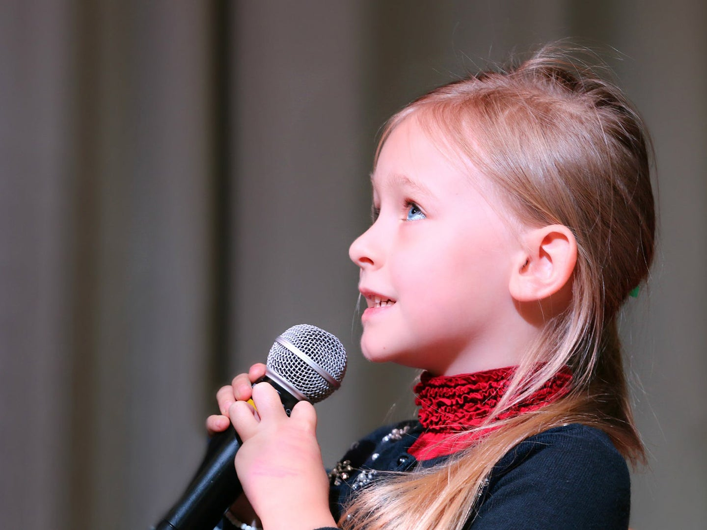 Young kid with a microphone