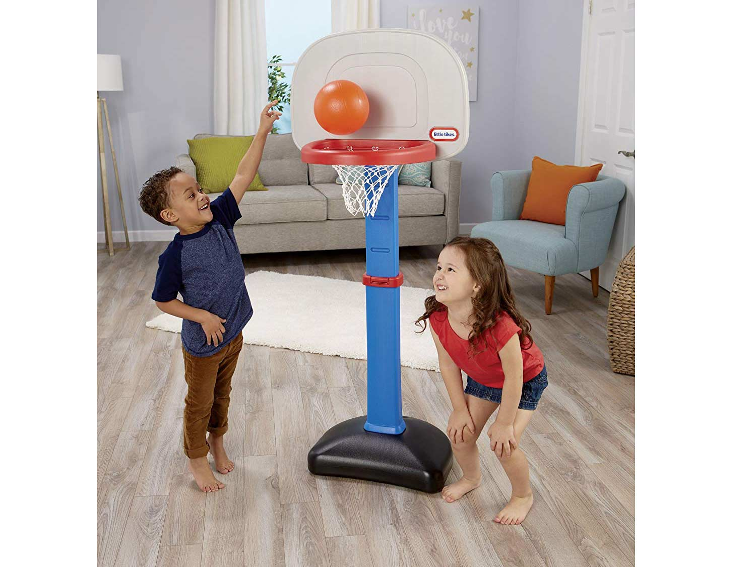 two young kids playing basketball