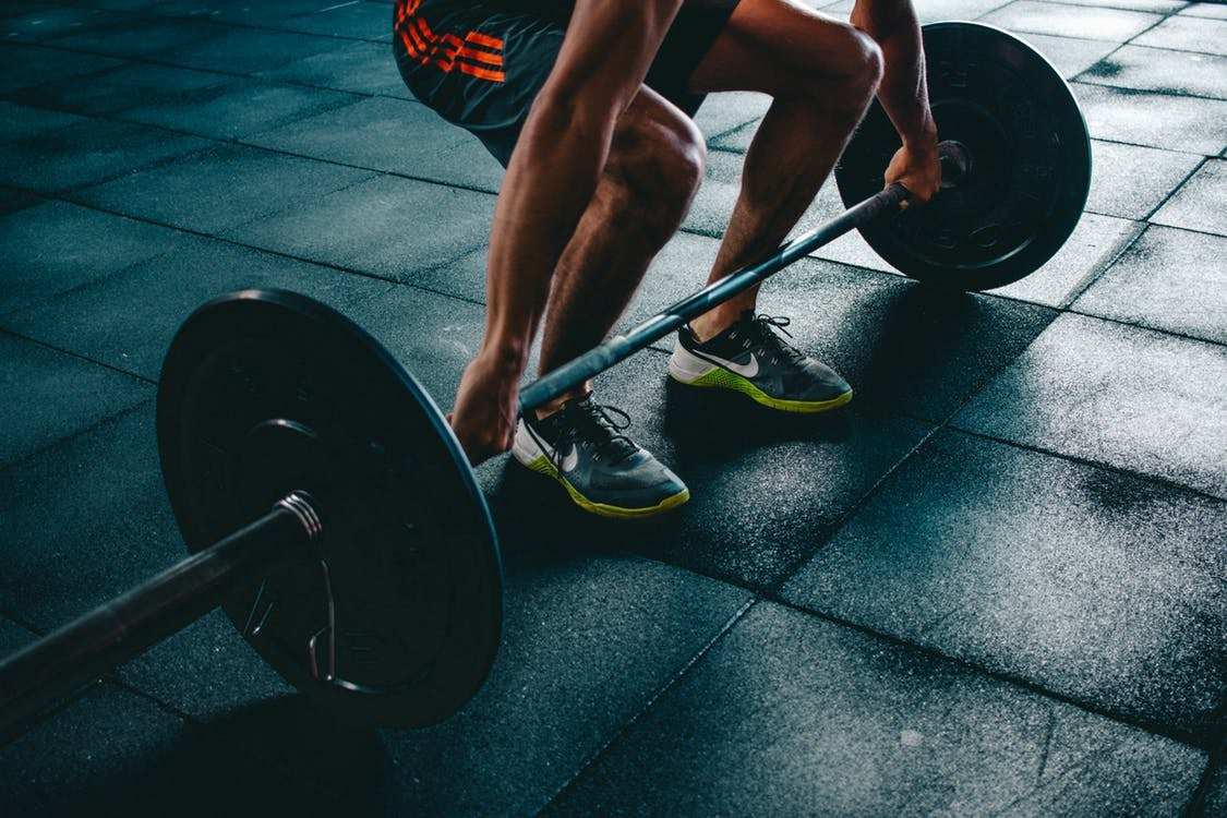Male adult lifting weights