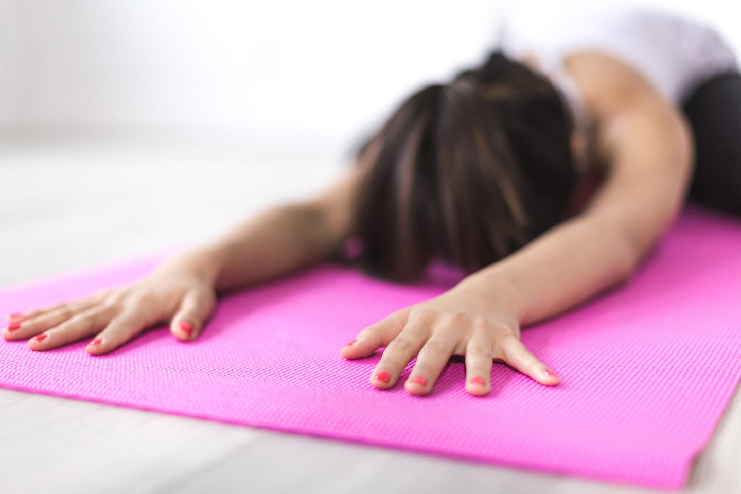 Woman stretching on a yoga mat.