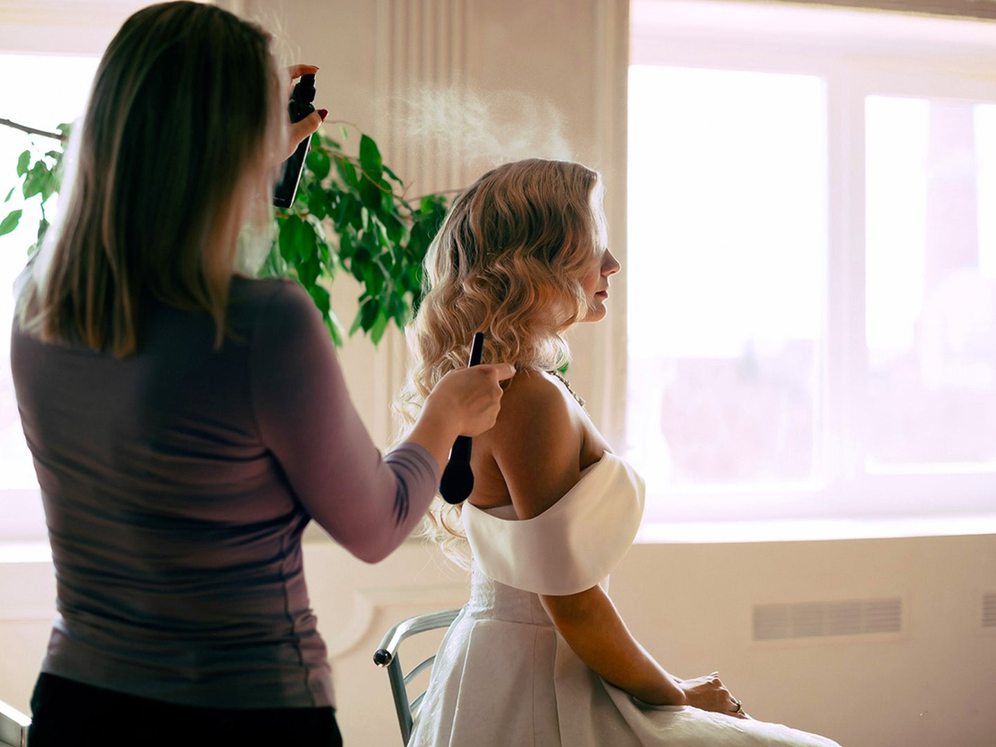 Woman getting her hair dressed up.
