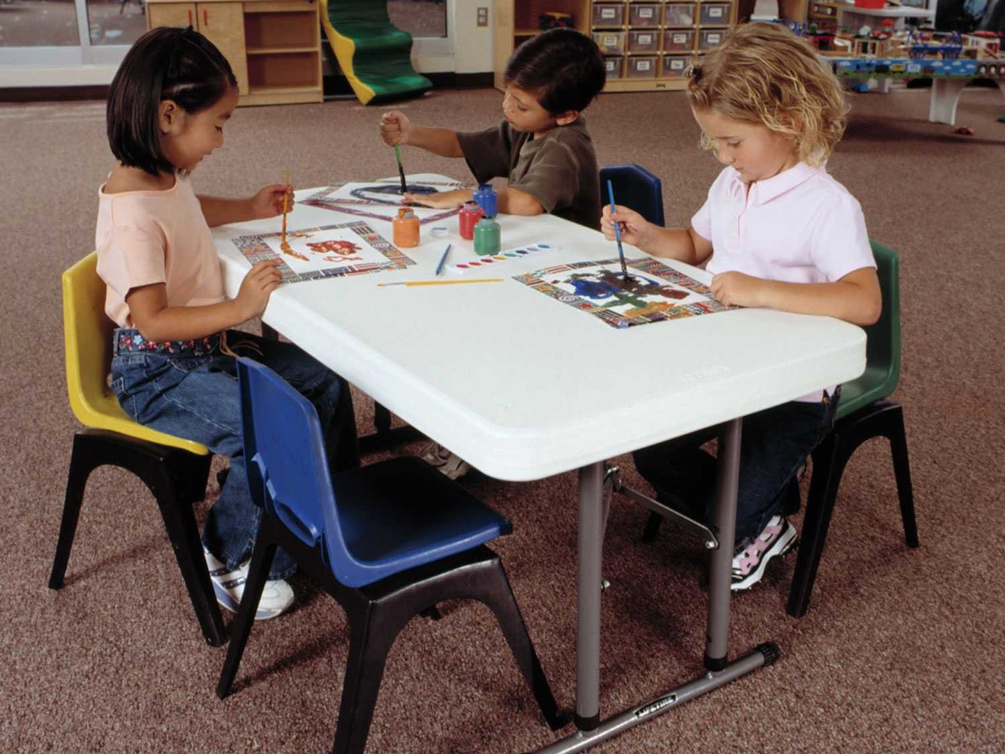 Kids sitting at a portable table
