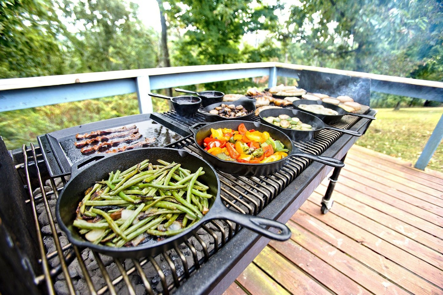 Cast iron cookware on a grill.