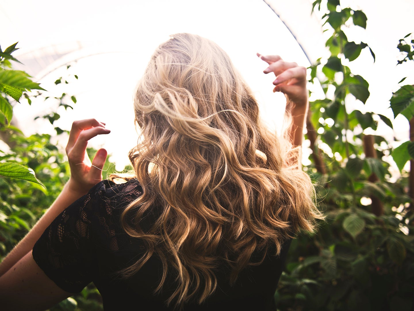 Woman playing with curly hair