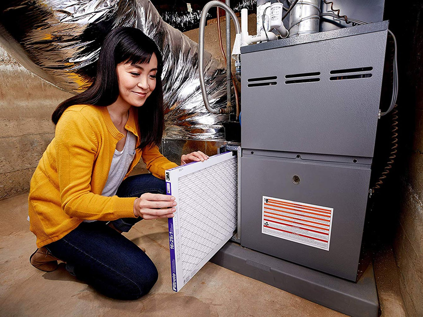 Woman changing air filter