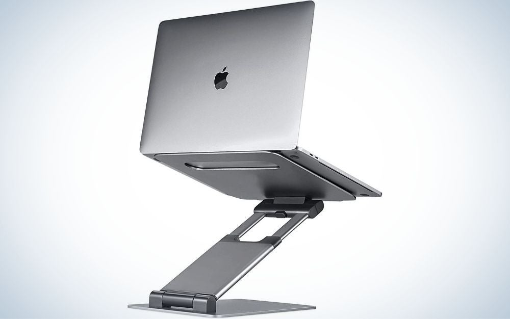 A silver laptop placed on a silver laptop holder with three folds to make it easier to raise and lower the laptop to the length we want.
