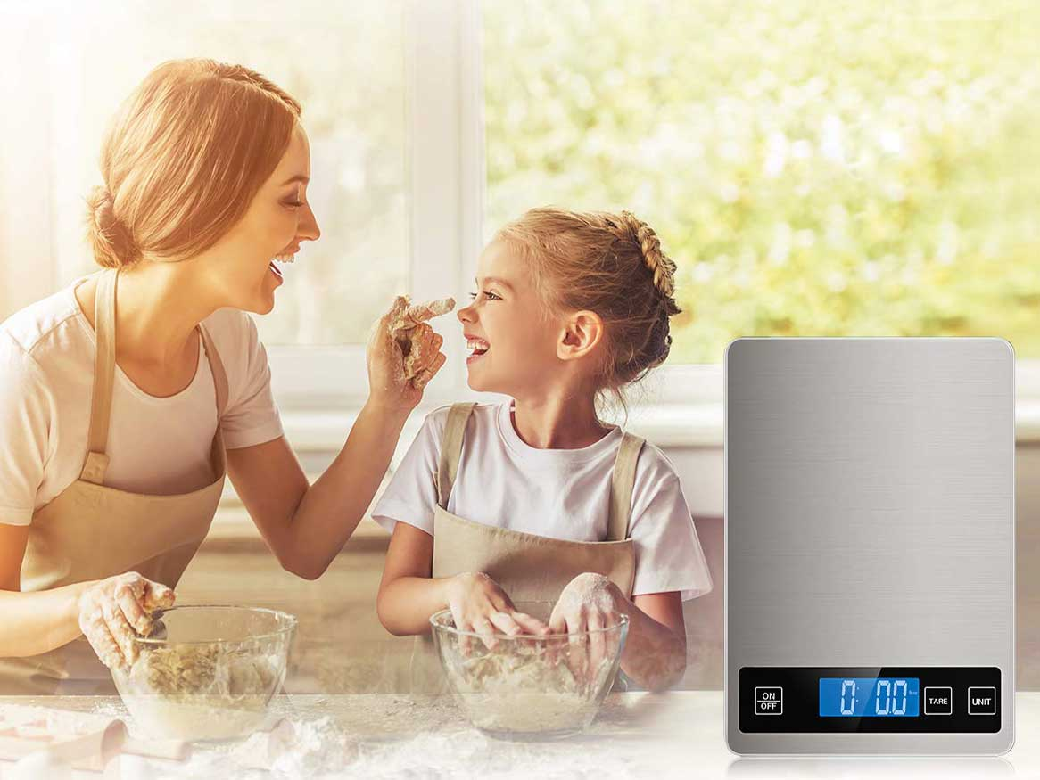 Mother and daughter bake with kitchen scale