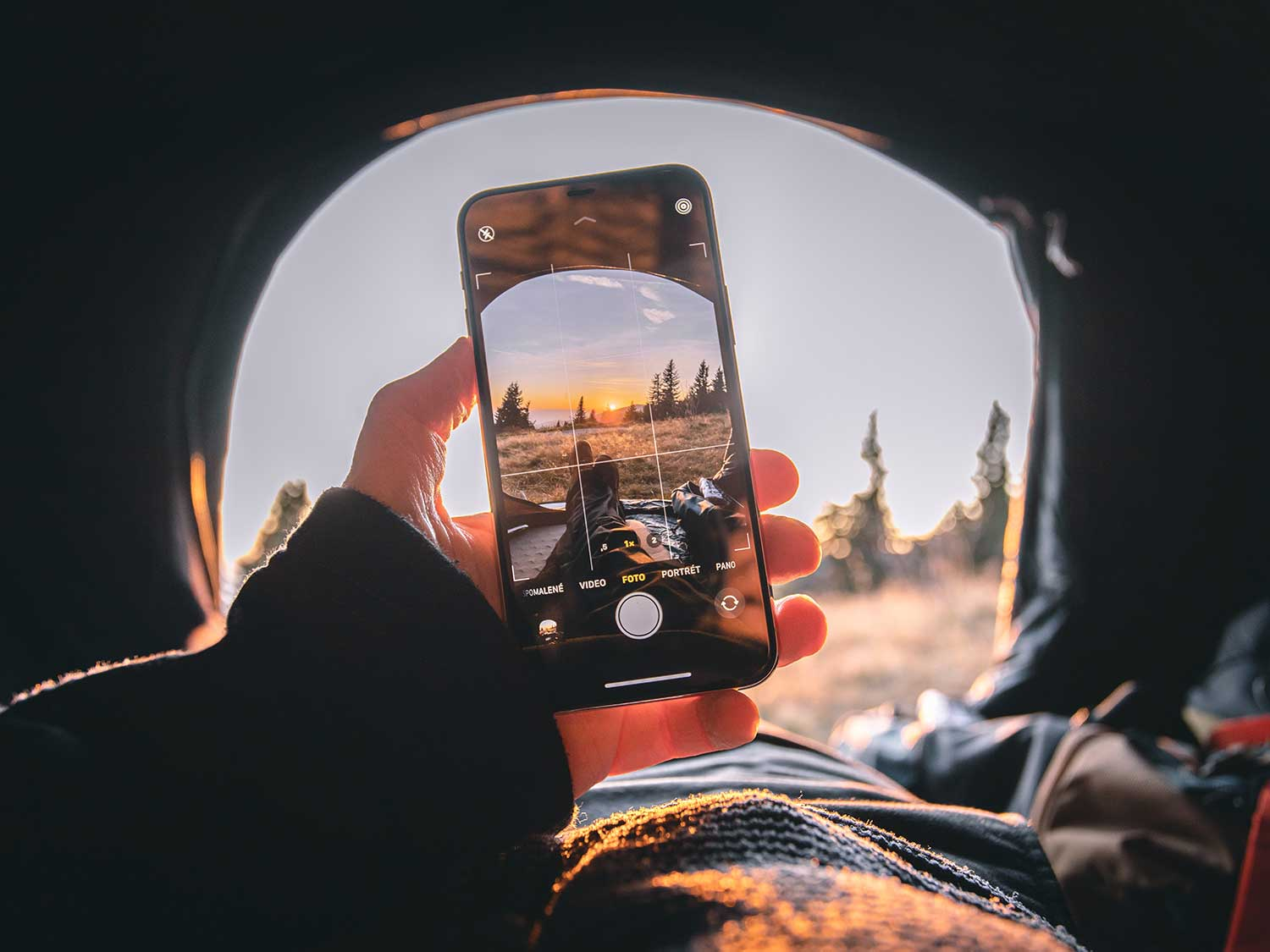 A person takes a picture with their smartphone.