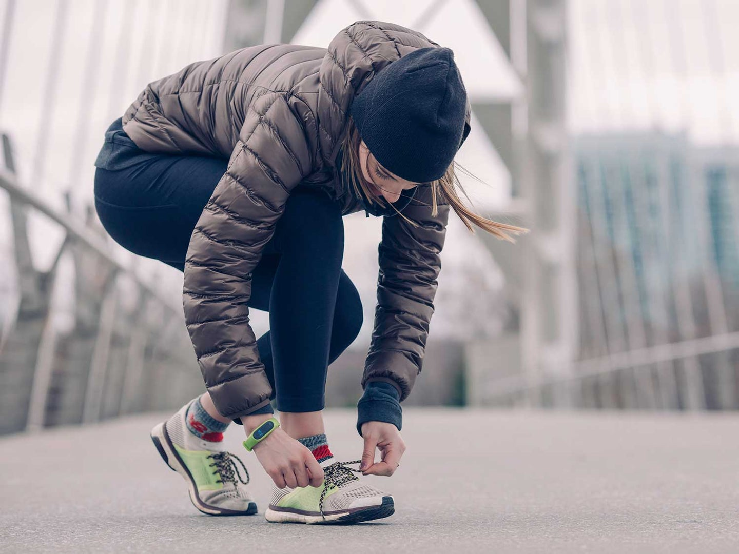 Woman ties running shoes