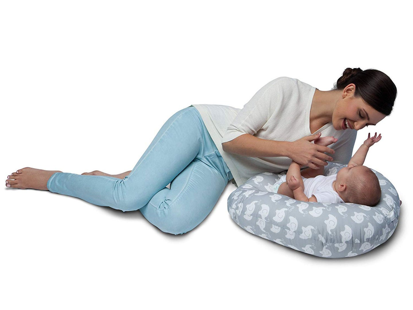 Woman watching baby on a pillow