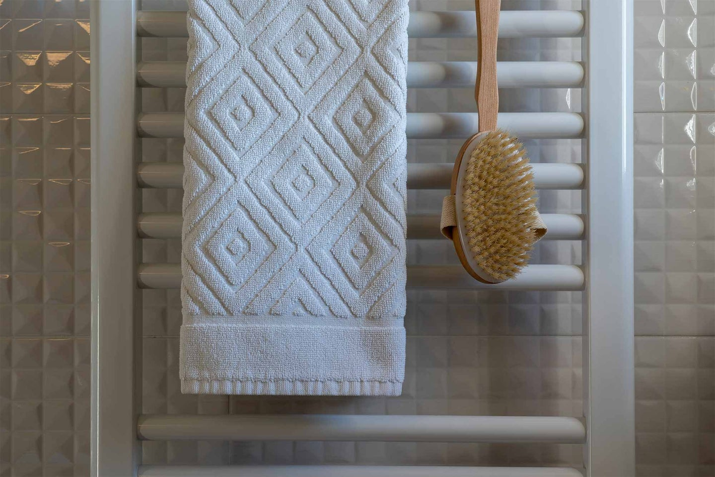White towels hanging in a bathroom