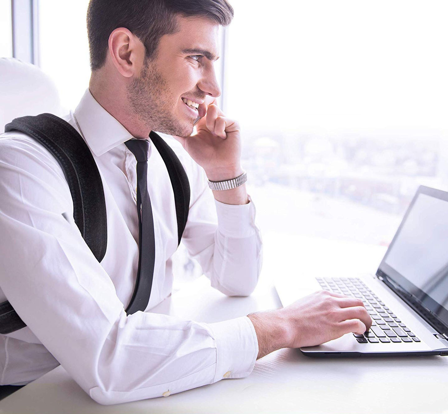 Man working at an office at a laptop