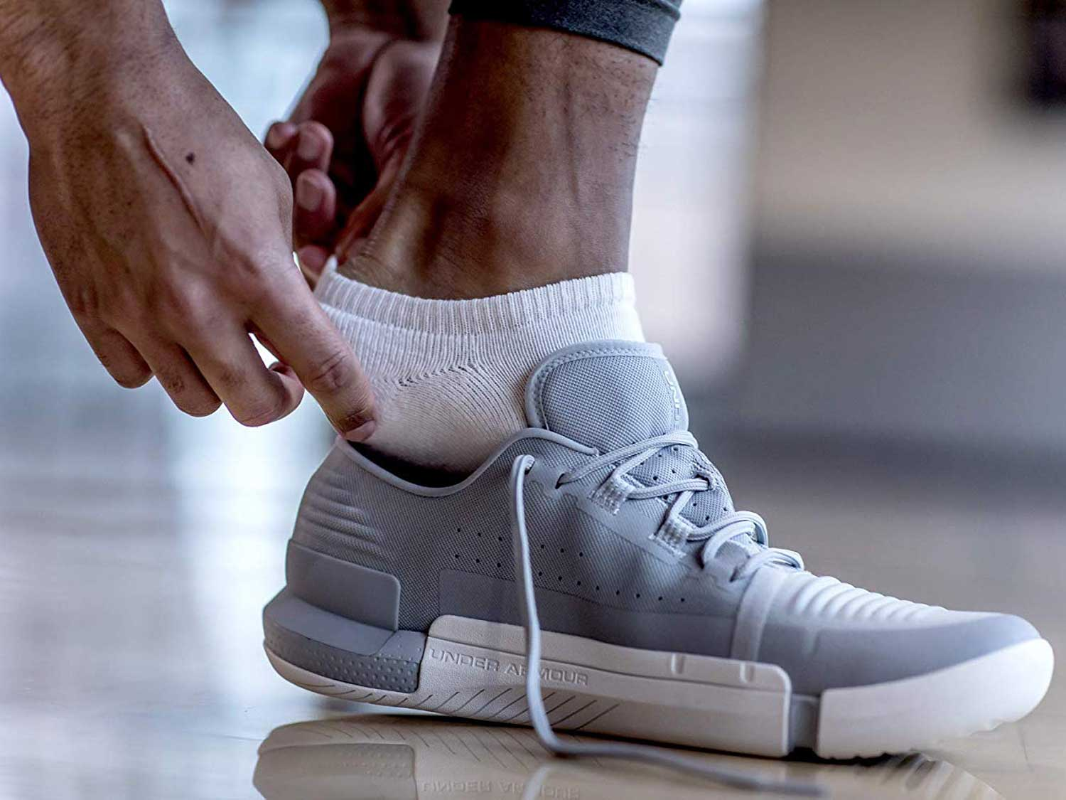 Putting shoe on over ankle socks