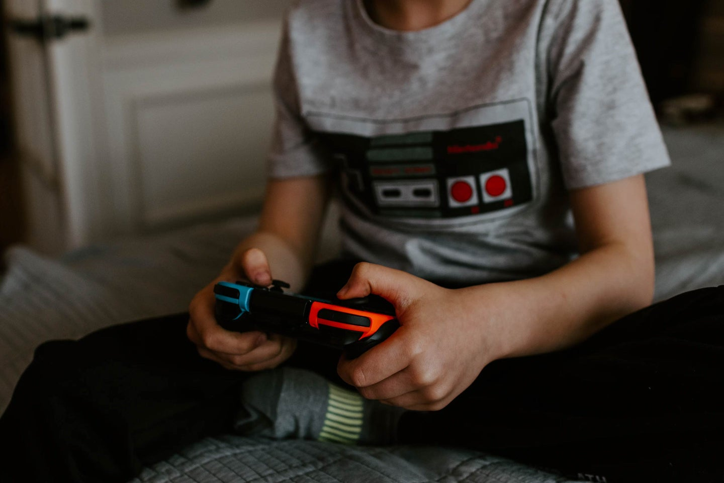 Little kid playing a video game