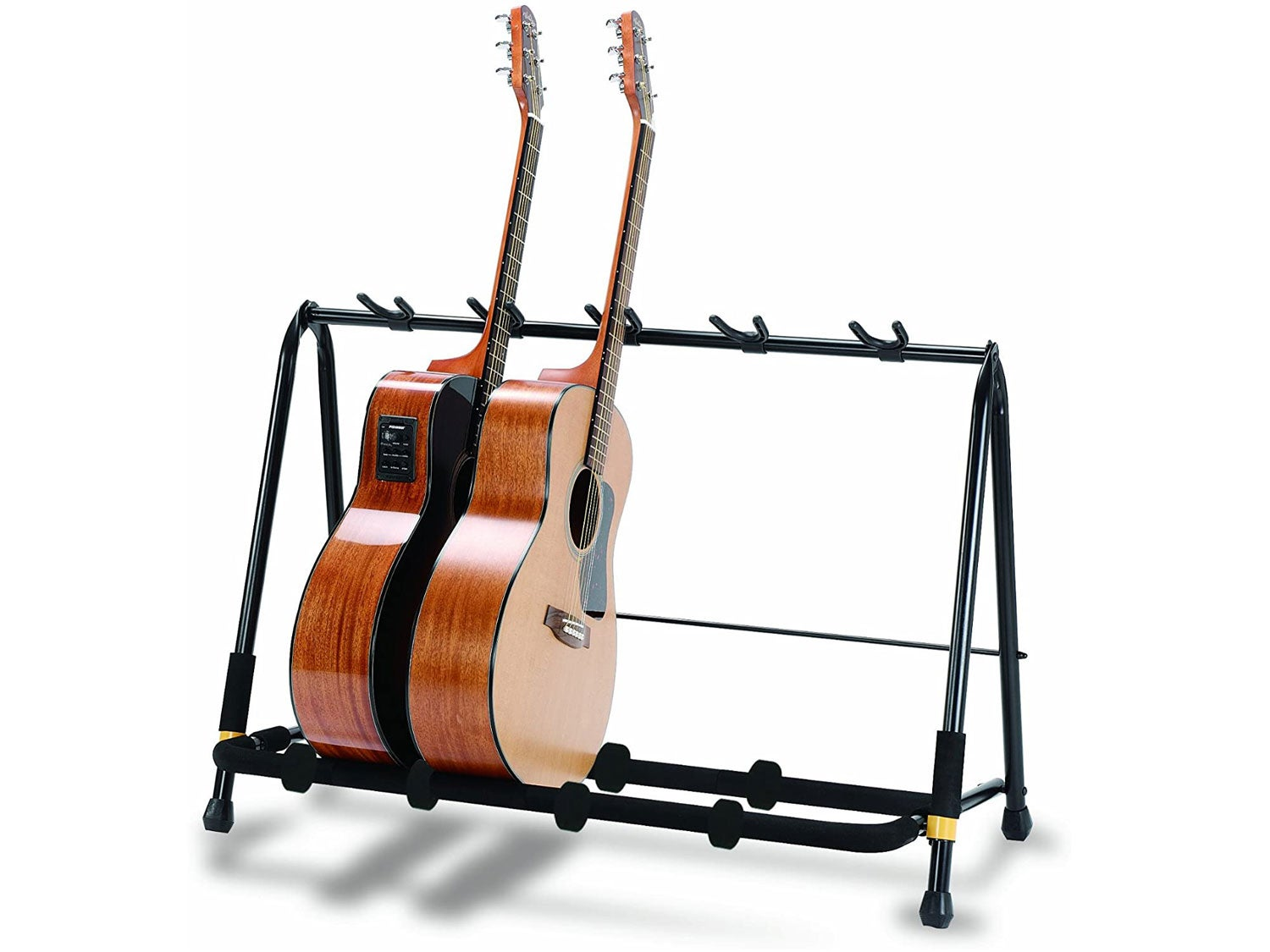 Two acoustic guitars on guitar rack