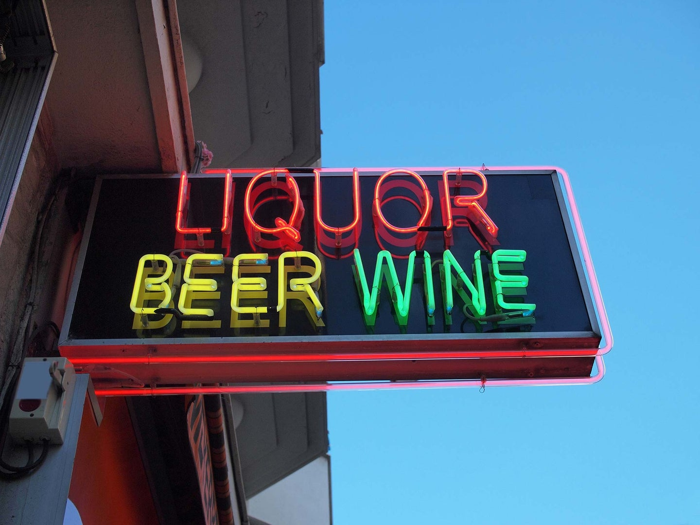 Neon sign advertising liquor, beer, and wine