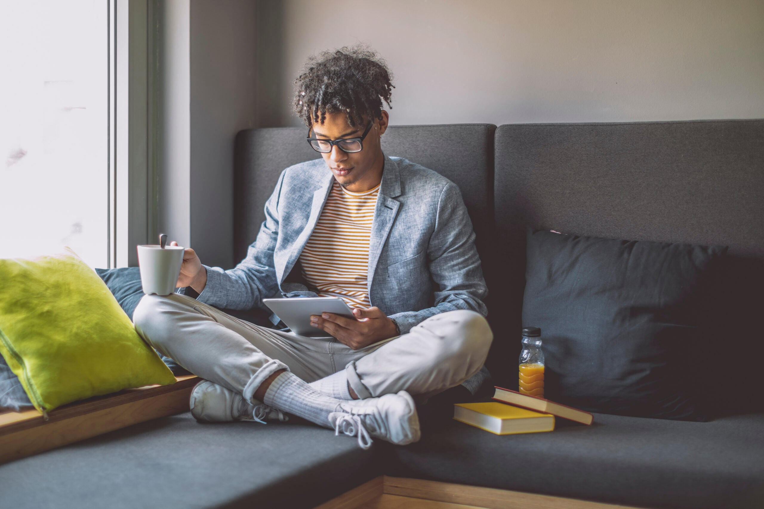Man reading a book on the couch