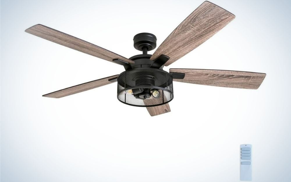 A wooden color ceiling fan with black head and motor in the center of it.