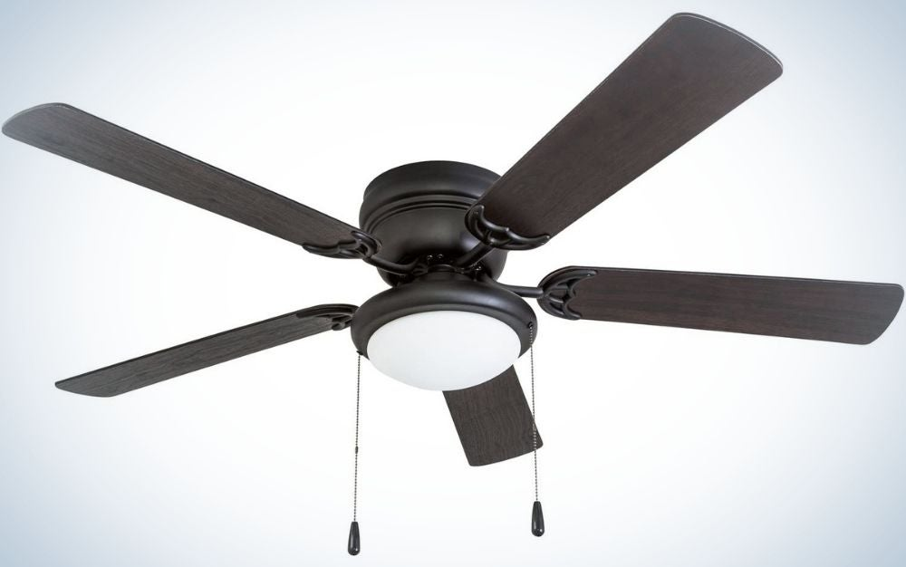 A black ceiling fan all with four leaves and a large light pot in the center as well as two connectors that hang to turn off and on.
