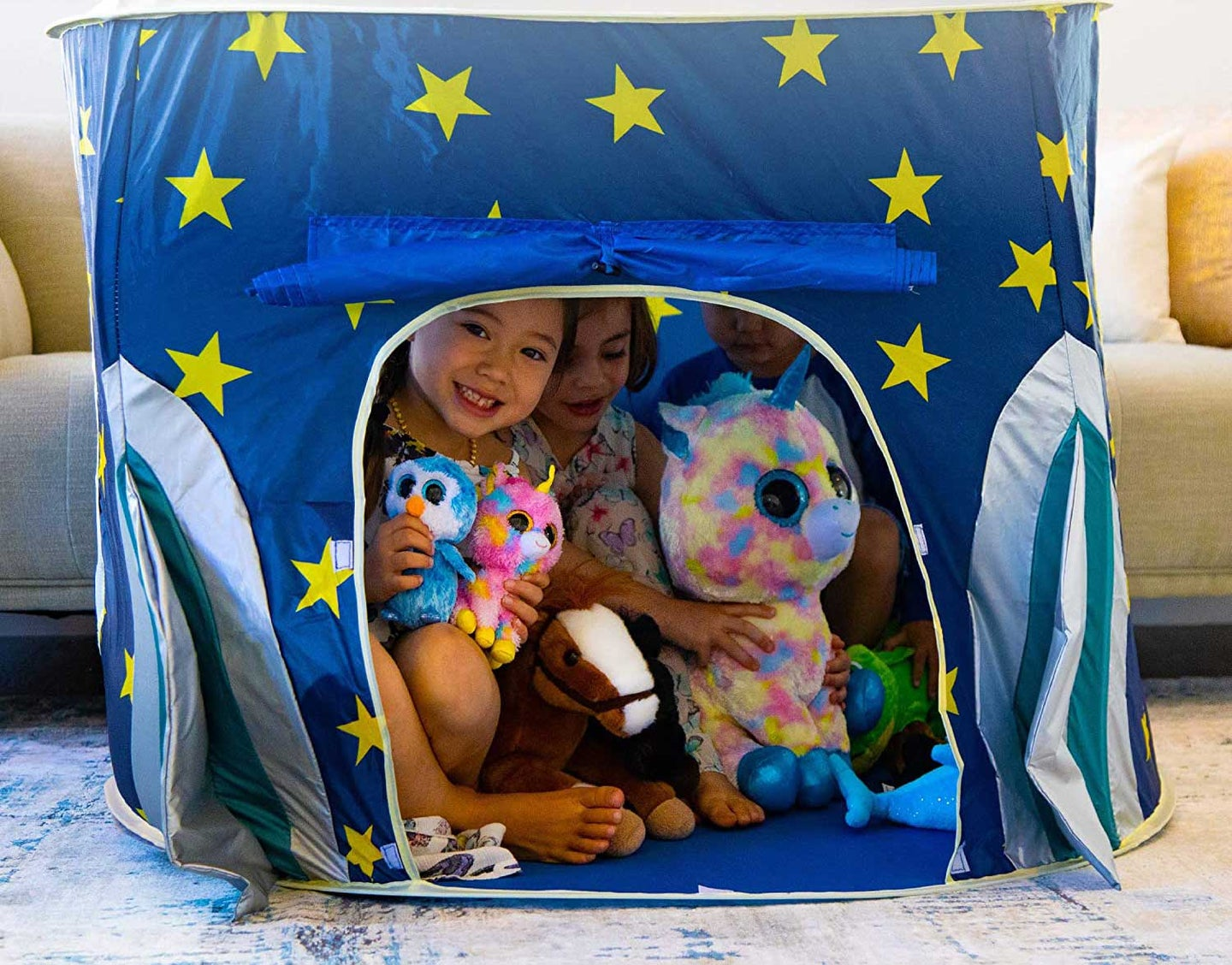 Two children playing in a tent