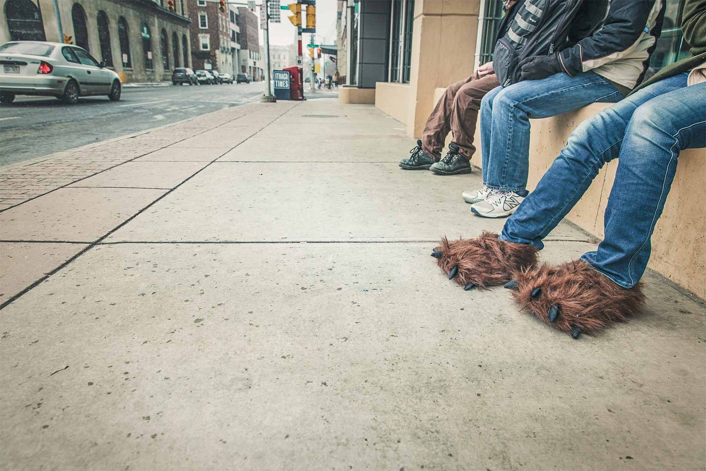 People on the street wearing funny slippers