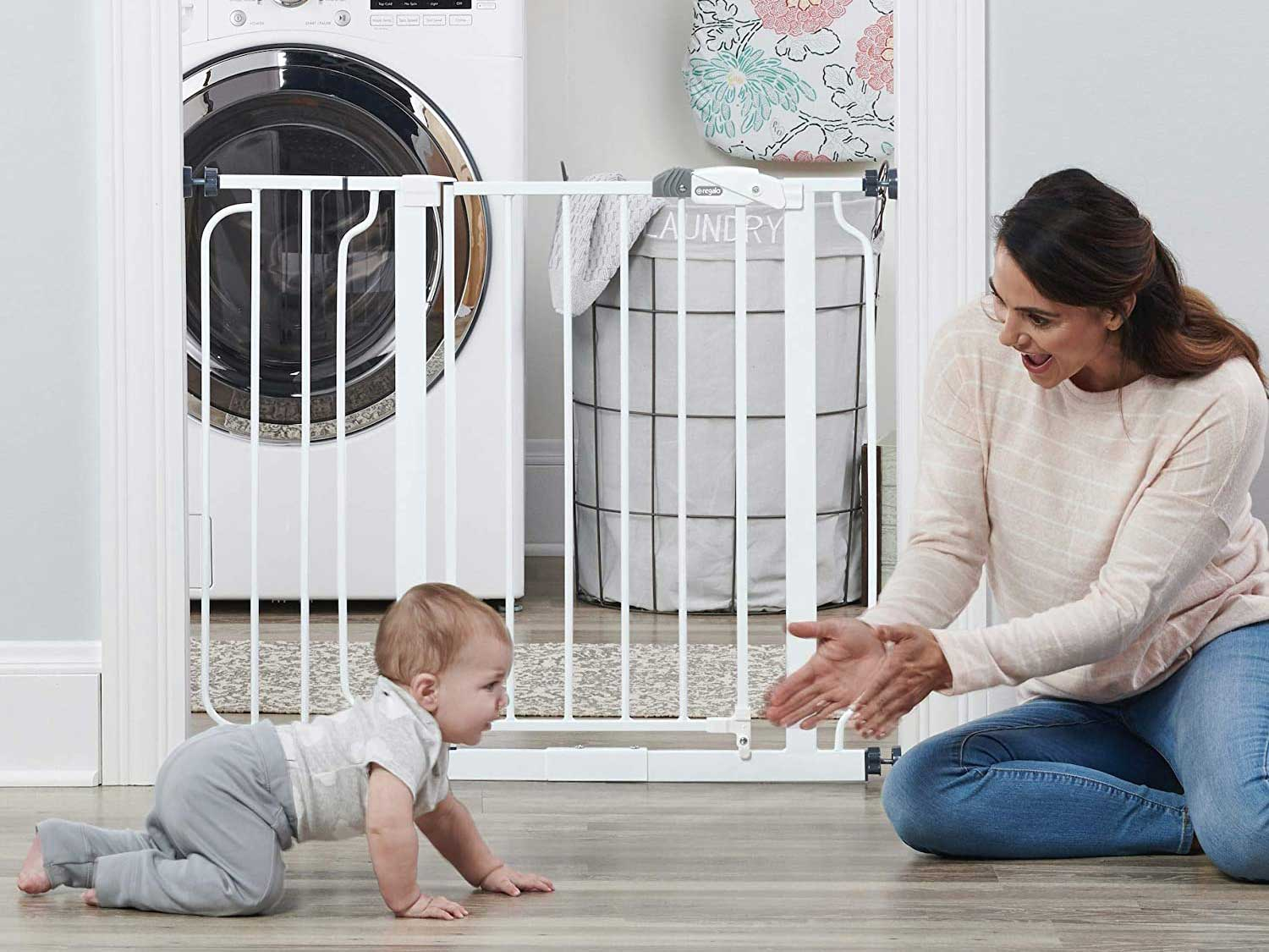 Mom and baby play in front of baby gate