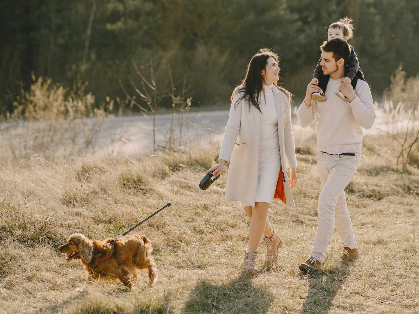 Family walking dog with retractable leash